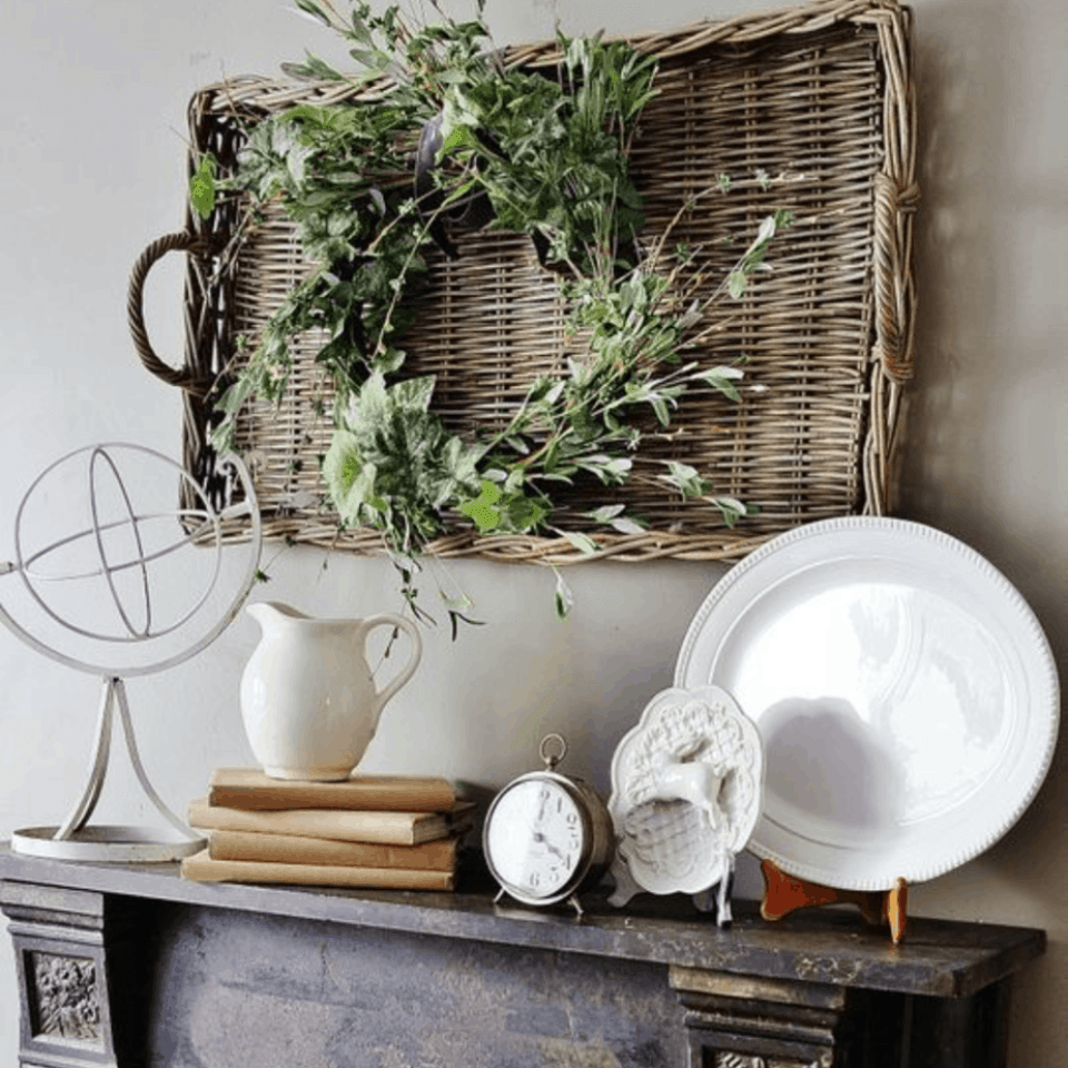 large basket tray on wall as art with a wreath in the center