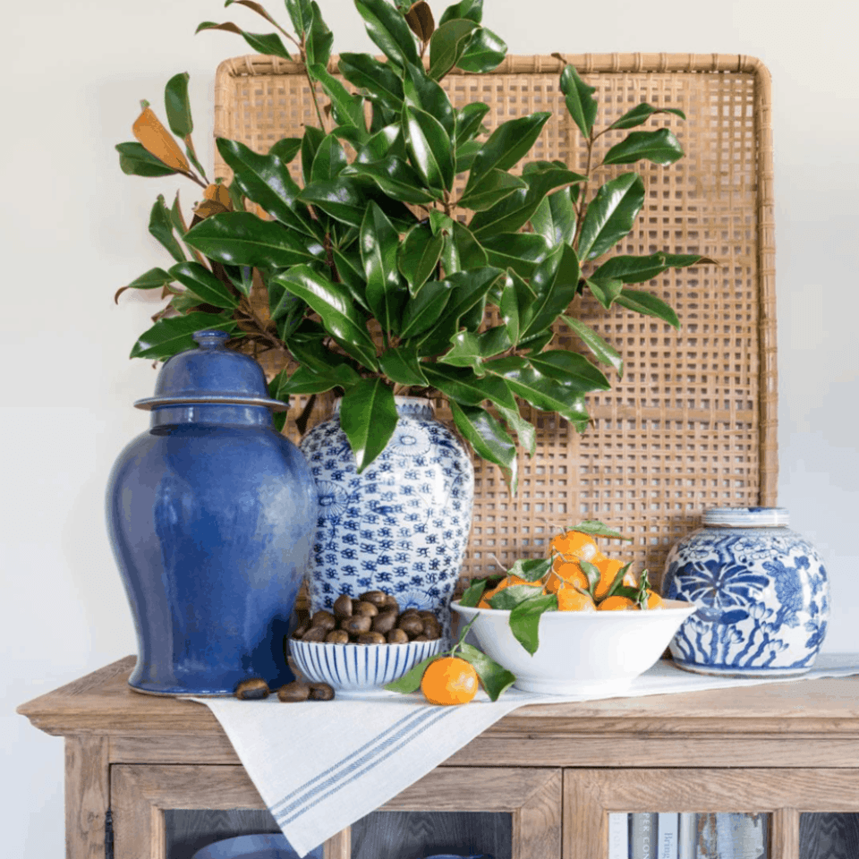 large woven basket over table with plant and jars on table