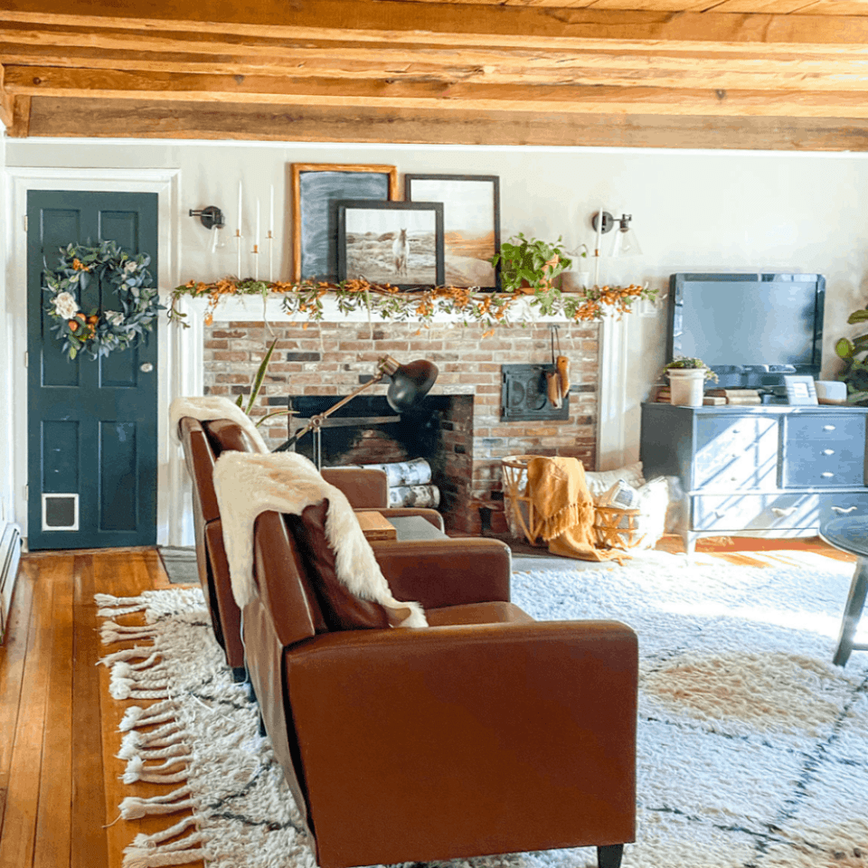 family room with brick fireplace and garland on the mantel