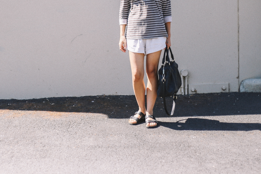 fashion blogger wearing Birkenstock sandals. Black leather bag.