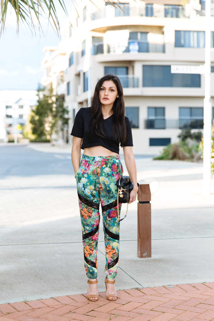 Floral statement pants by Elliatt. Asos crop top tee. Zara sandals. Dylan Kain bag.