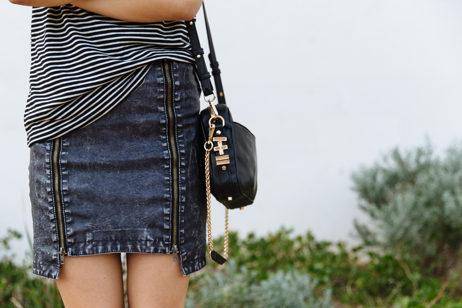 FATE denim look skirt. Dylan Kain bag.