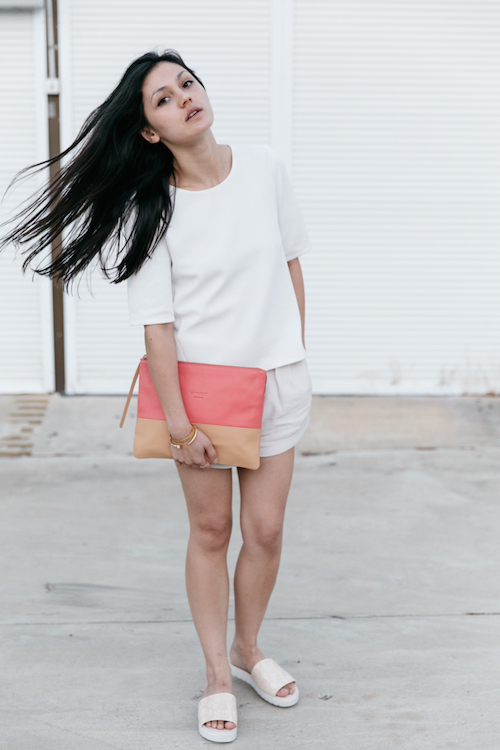 All white outfit with a colour block pencil case clutch.