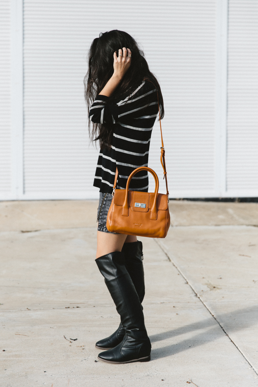 Black stripe top with denim mini skirt & knee high boots.