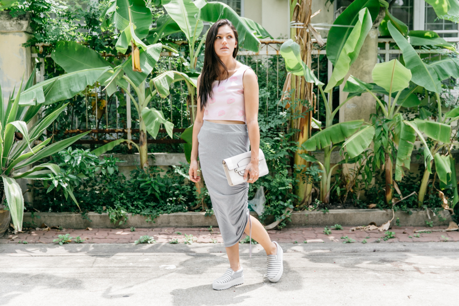 Platform sneakers worn with a draped skirt.