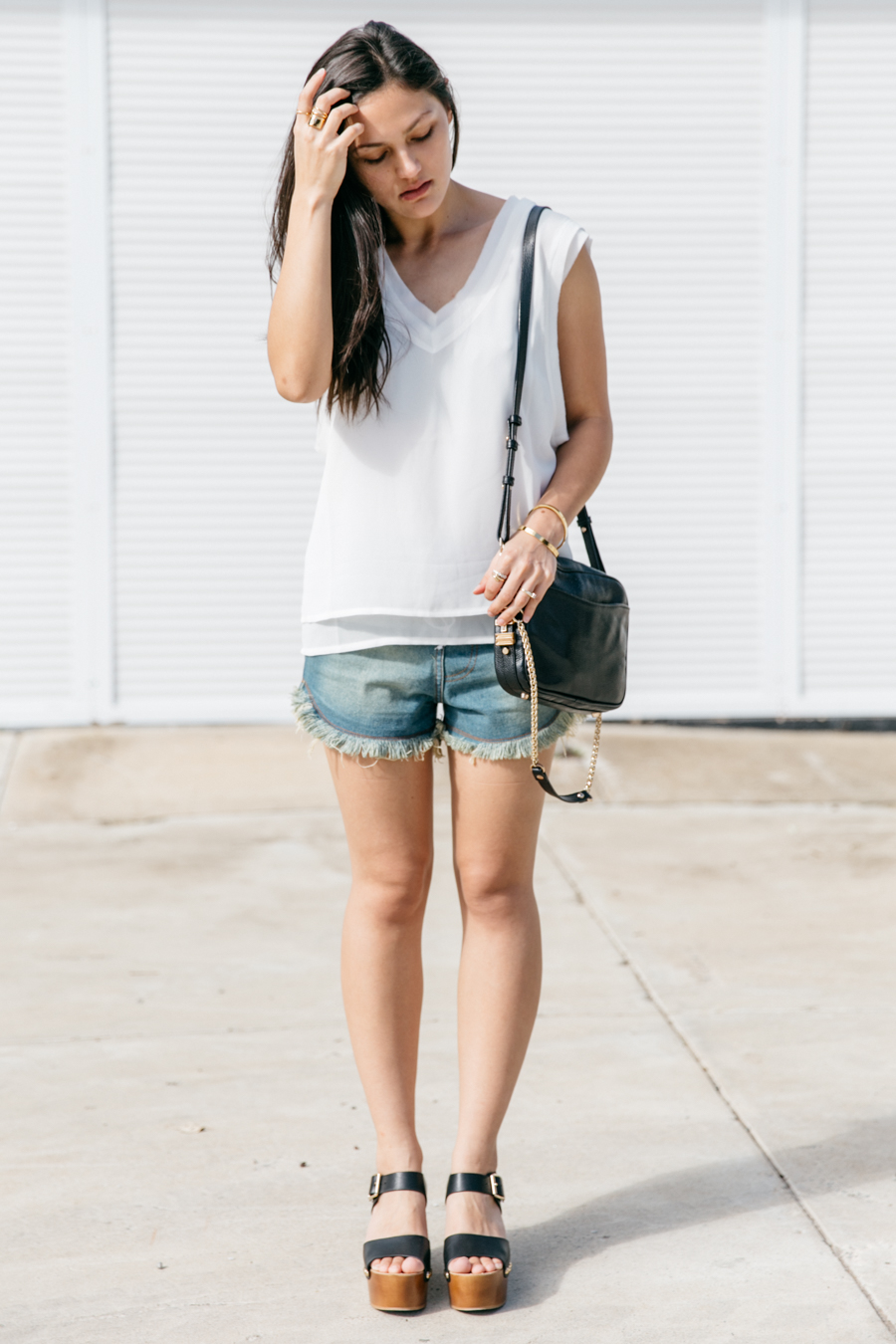 Simple denim shorts & white tank top outfit.