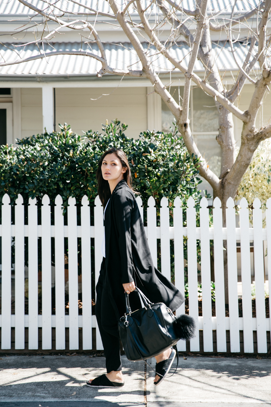 Long black coat for minimalist style.