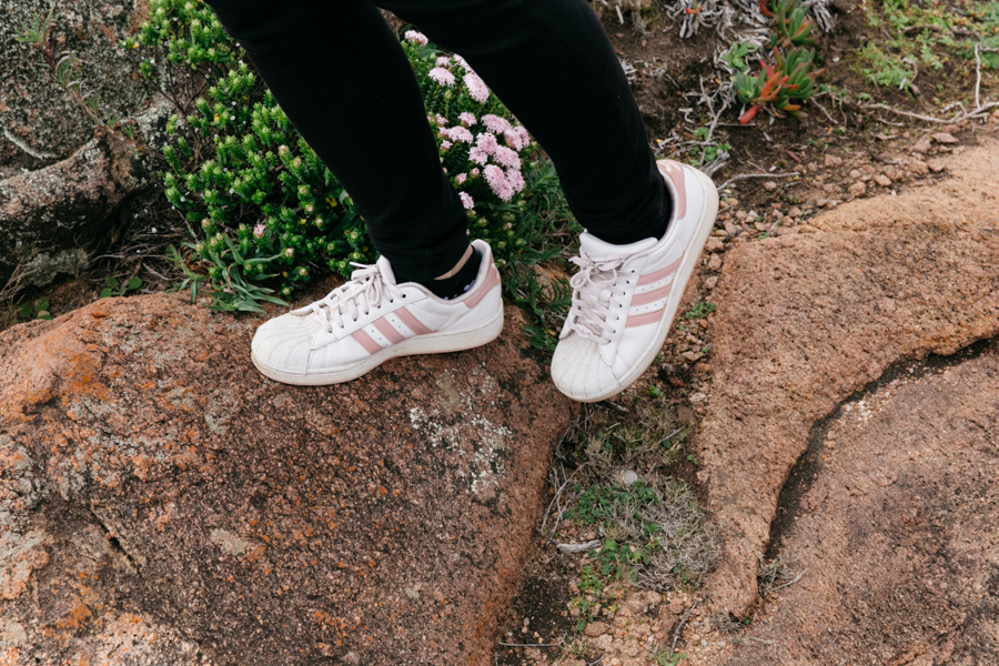 Pink & white Adidas Superstar sneakers.