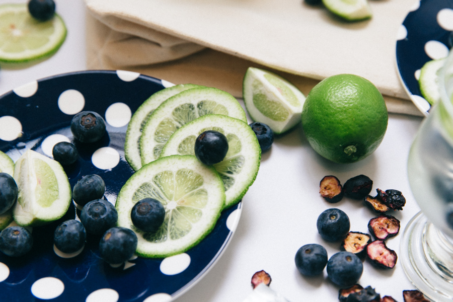 Kate Spade navy blue saucers with blueberries & limes.