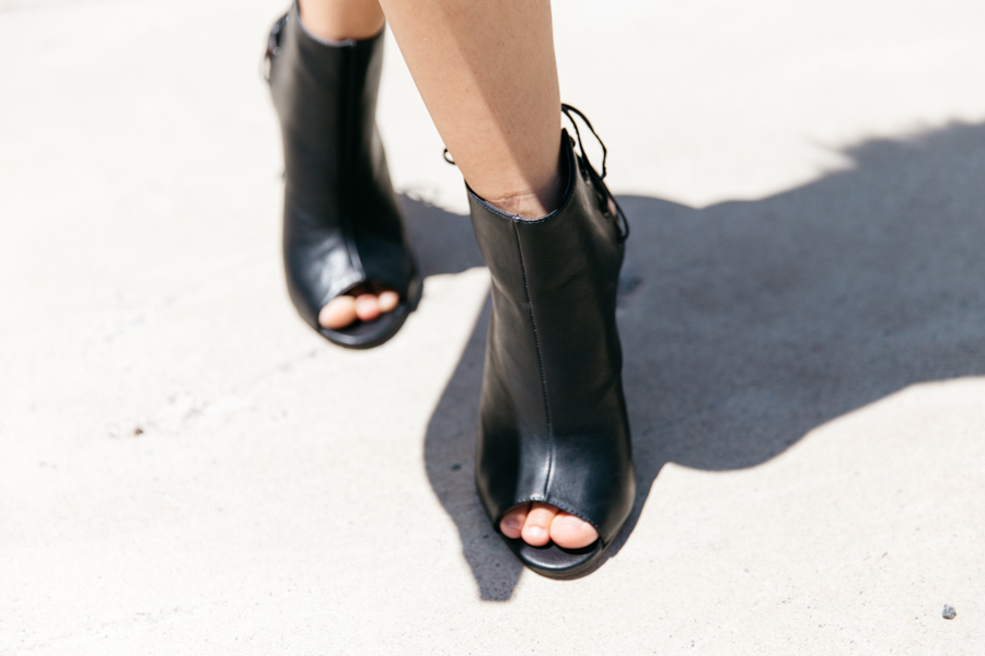 Lace up peep-toe black ankle boots street style.