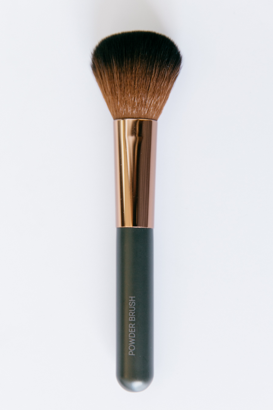 Nude By Nature powder brush.