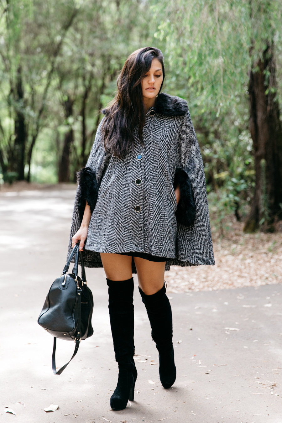 Fur cape & over the knee boots.