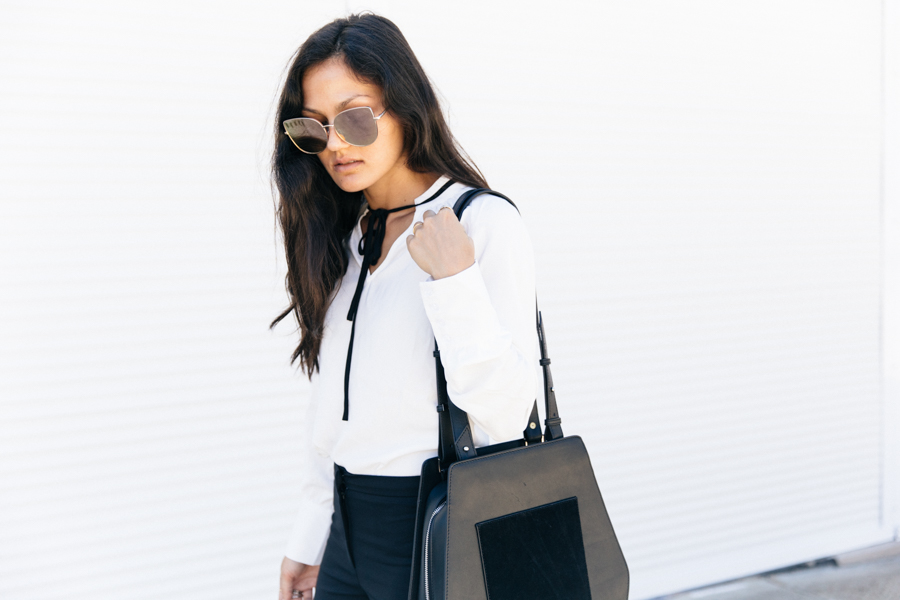 Minimalist girl boss professional outfit.