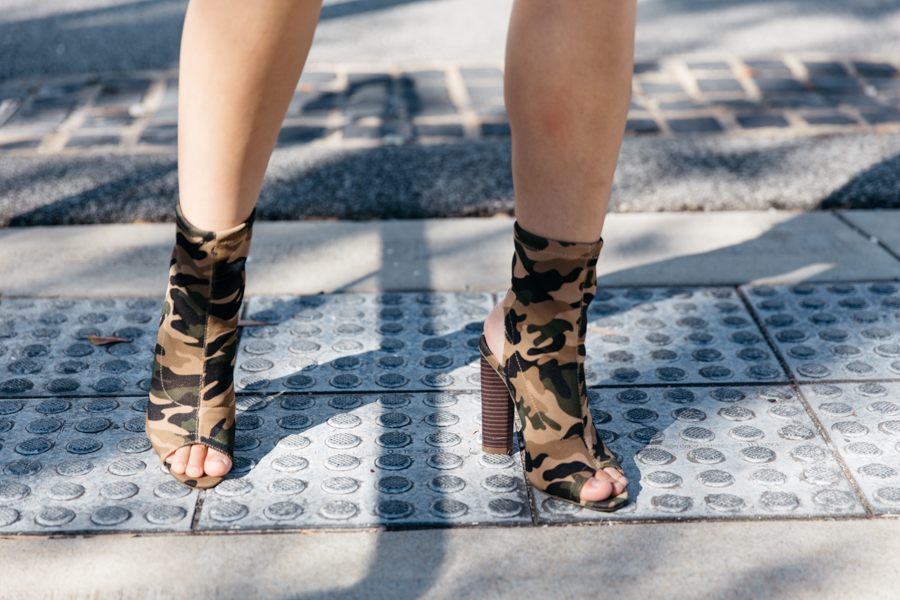 Sock bootie trend in camo. Kylie Jenner style outfit.