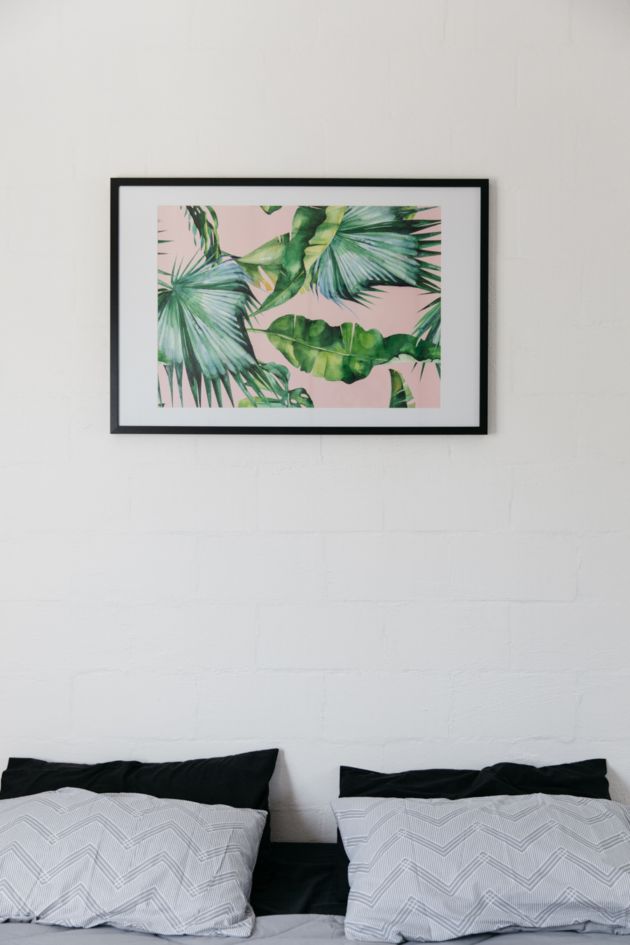 Tropical print poster - palm leaves on pink background.