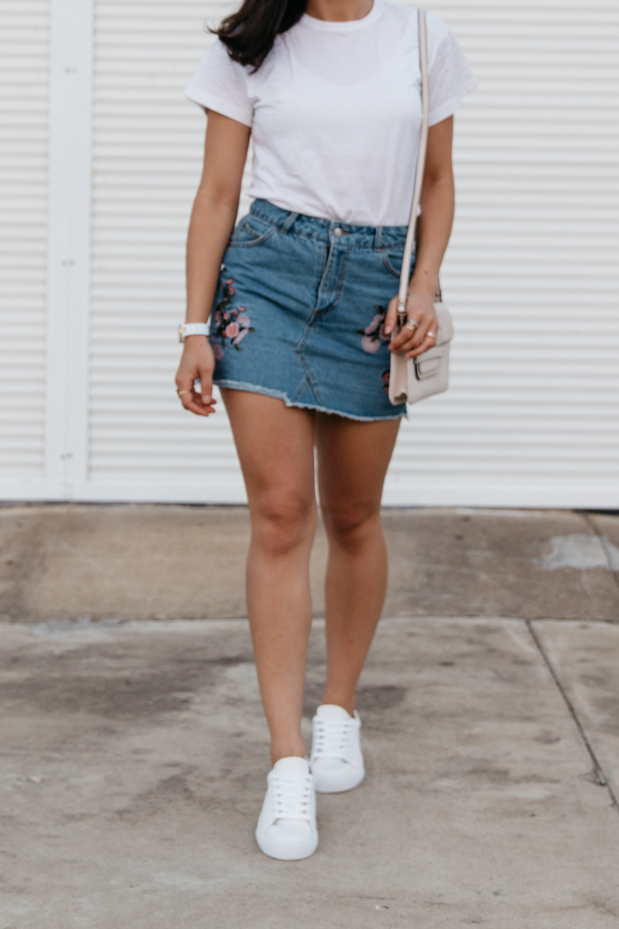 Embroidered denim skirt outfit.