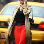 kate bosworth candid photo casual cool outfit- long red skirt- black top- burberry trench coat- black chain purse- black wayfarer sunglasses-simple style makeup