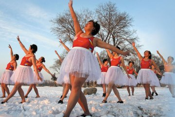 Former dancers stay fit on a snow-covered lake in Changchun. Many Women born in China during the 1950s made tremendous sacrifices so that there children could have a better life.