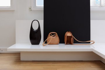 Christophe Lemaire's fall:winter 2014 collection featured two styles of seamless, hard bags