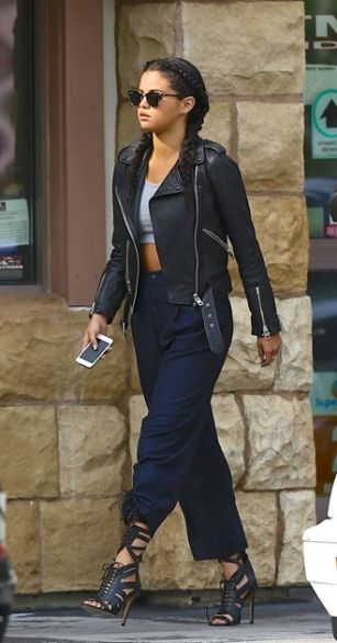 02 Aug 2014, Los Angeles, California, USA --- EXCLUSIVE: Selena Gomez steps out in a crop top, leather jacket and braided hair as she is seen leaving a convenience store with a friend. Pictured: Selena Gomez --- Image by © Splash News/Splash News/Corbis