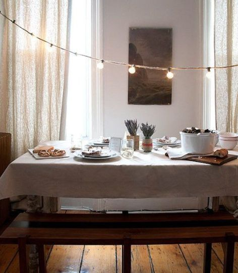 string lights over dining table