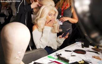 Gigi Hadid backstage getting prepped for Jeremy Scott