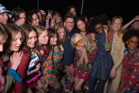 Models hugging Henry Holland backstage at House of Holland
