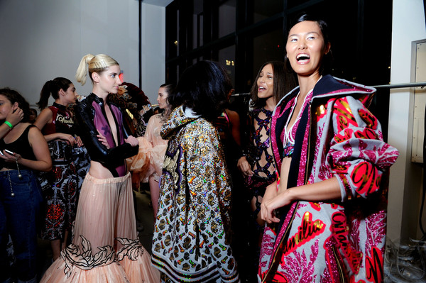 Models giggling backstage at the VFILES show.