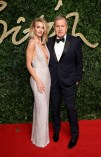 Rosie Huntington Whitely and Mario Testino attends the British Fashion Awards 2015 at London Coliseum on November 23, 2015 in London, England.