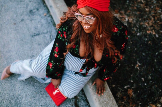 plus size travel, floral top, stripe pants, YSL red purse, red turban, gold glasses