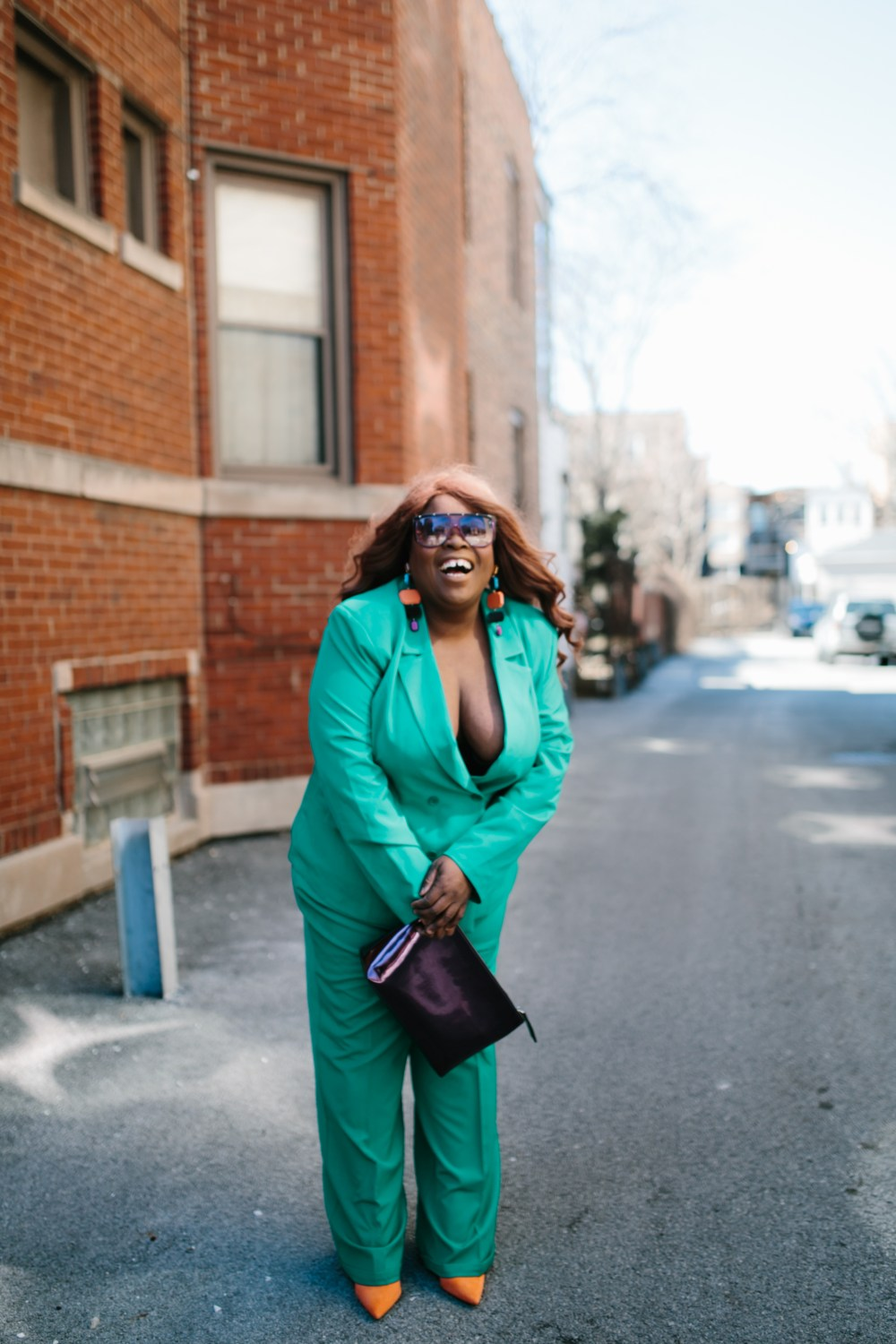 plus size fashion blogger in green suit