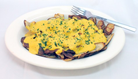 Potato skins with cheese sauce