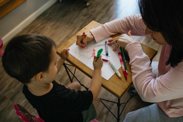 gabe_pierce artistl; Teacher coloring with a child.