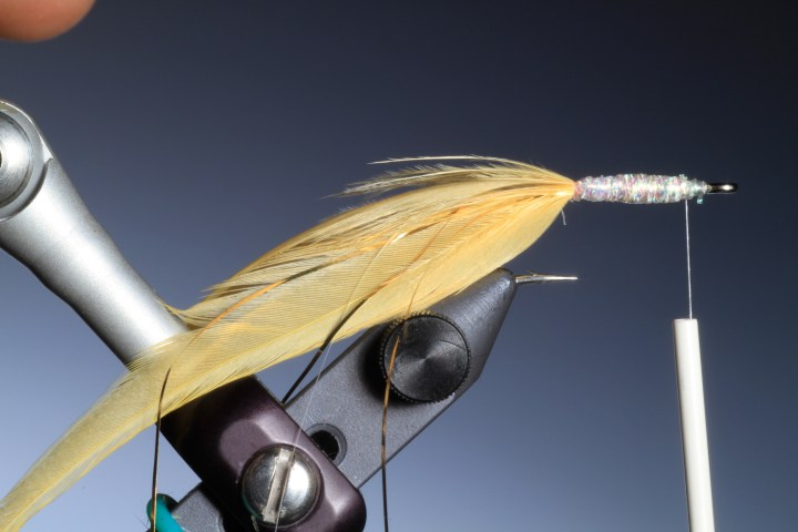4. Wrap the body braid over the whole hook shank taking care to leave enough space for the wing and head.