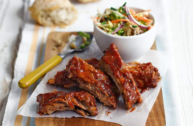 teriyaki ribs with a green salad in the background