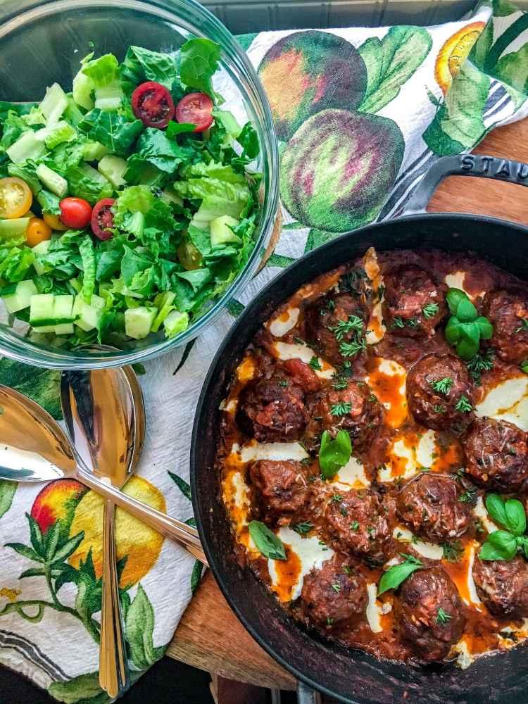 skillet with Marinara Meatballs and a salad bowl