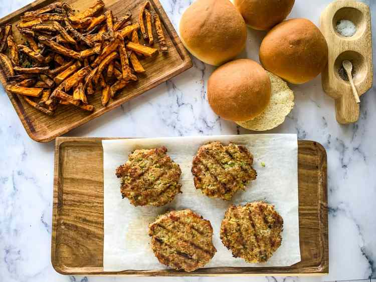 Turkey Burgers and buns with roasted sweet potato fries ready to serve