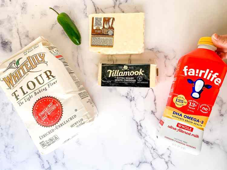 Photo of recipe ingredients: self-rising flour, cheddar cheese, jalapeno pepper, and milk
