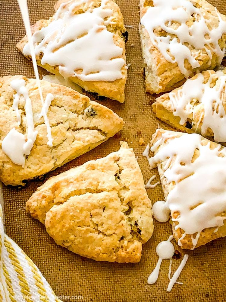 cranberry nut scones made with cream being iced