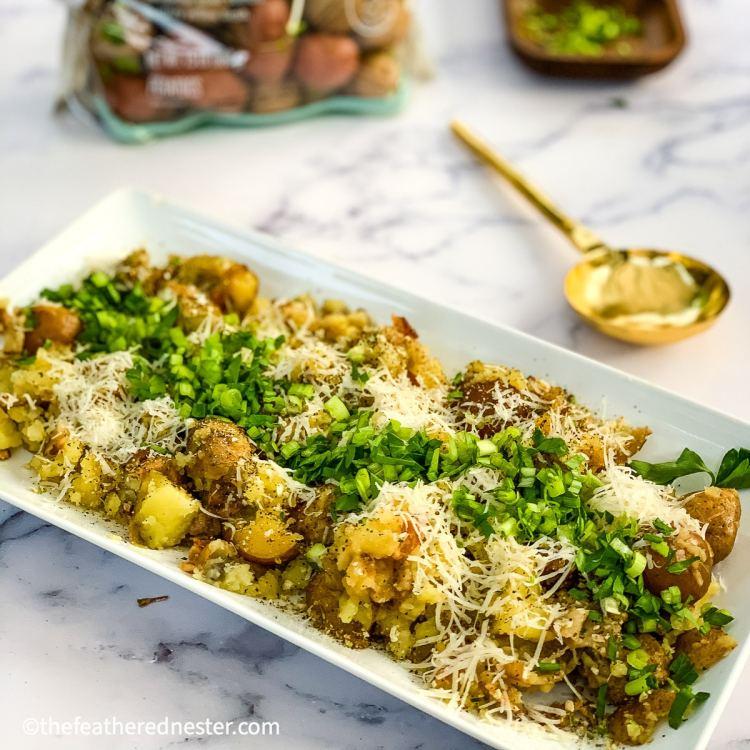 instant pot parmesan potatoes on a platter ready to serve