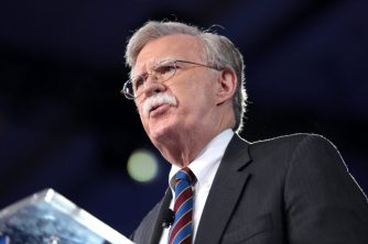 Image result for John Bolton with the book""