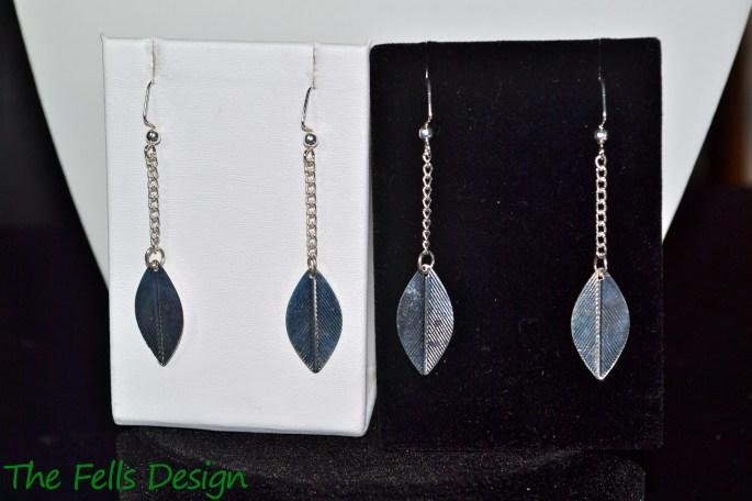 Silver boho feather charm earrings
