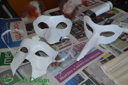 Three CosPlay Masks with a white base to cover over the ink from the newspaper
