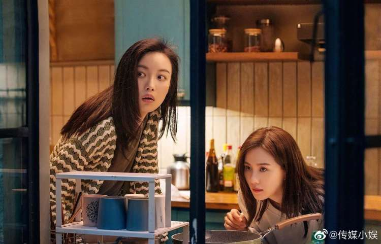 Liu Shishi and Nini's characters looking outside their apartment in My Best Friend's Story