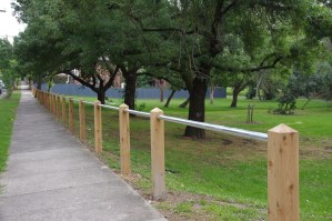 timber post and steel rail fence, timber post and pipe rail fence,