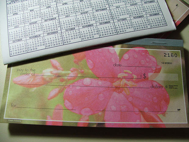 Image of a checkbook represent making alimony payments
