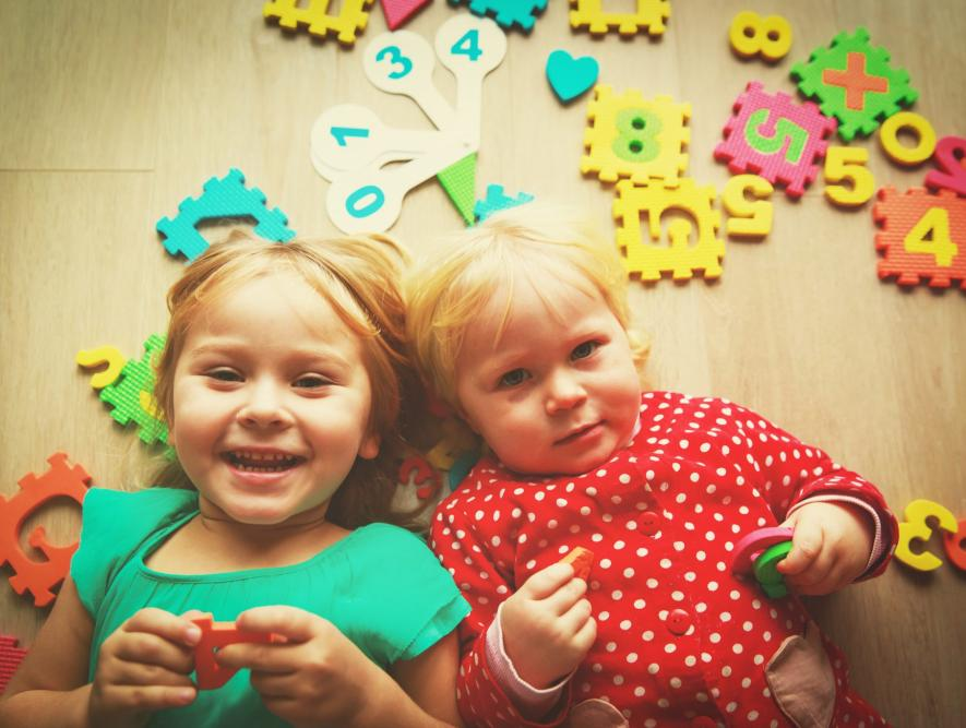 happy cute little girls learn numbers and calculations