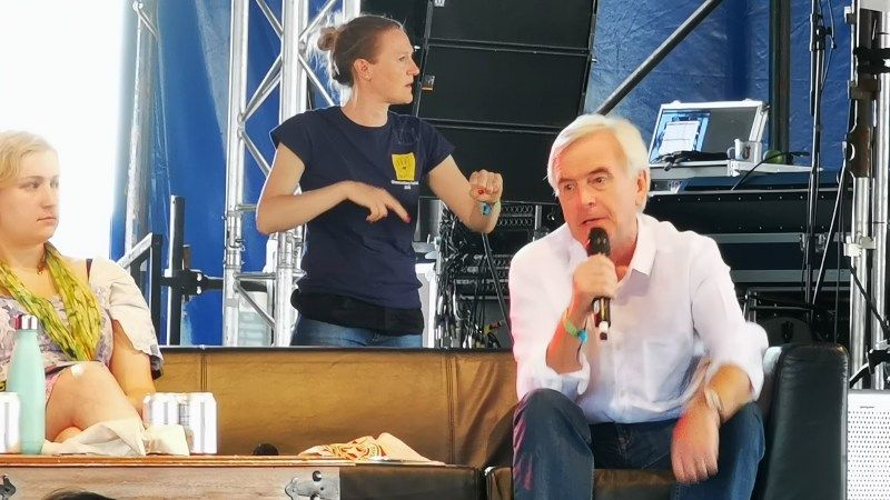 John McDonnell speaking into microphone at Leftfield Glastonbury 2019