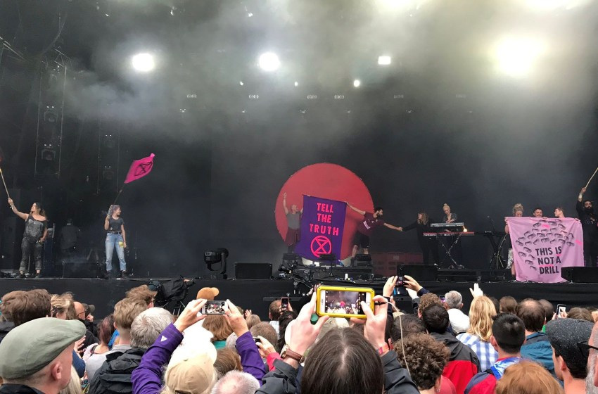 Extinction Rebellion activists 'storm the stage' during Kate Tempest's set at bluedot