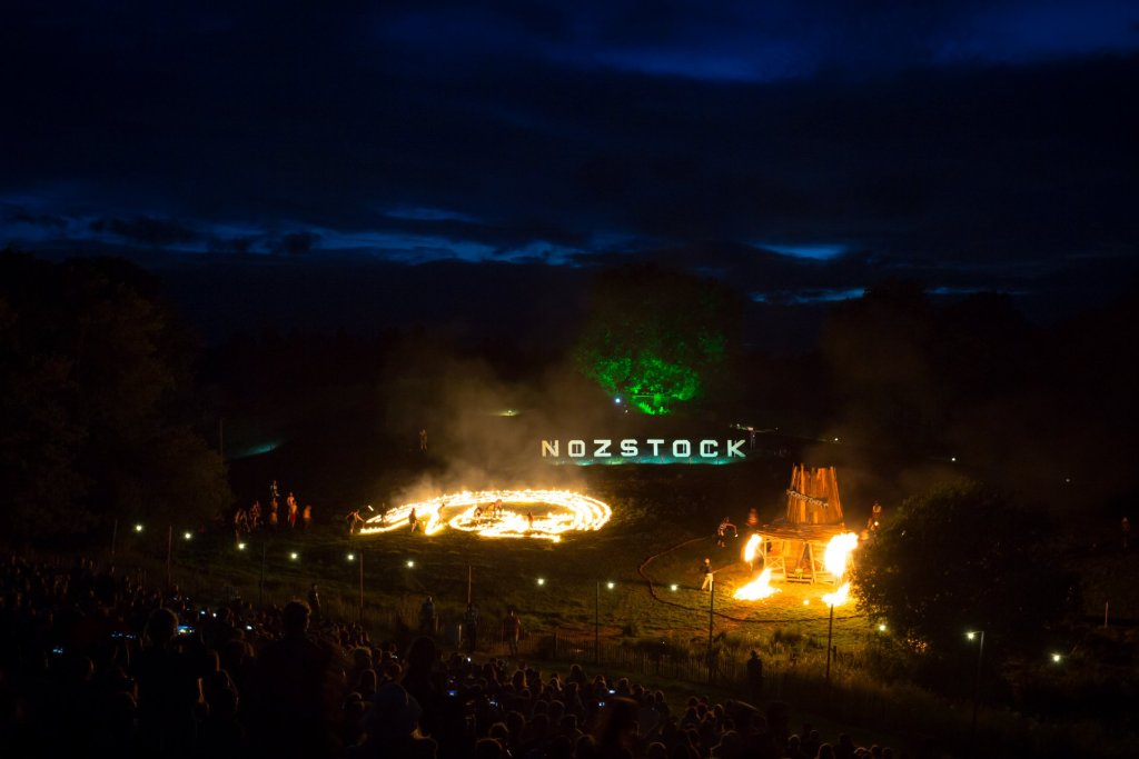 Nozstock sign and fires at night